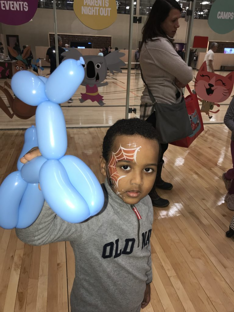 Boy Holding Balloon Dog